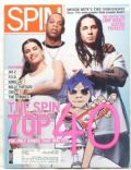 Jay-Z, Nelly Furtado on the cover of Spin (United States) - April 2002