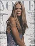 Carmen Kass, Nicholas Moore on the cover of Vogue (Spain) - January 2006