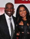 Tracey E. Edmonds and Deion Sanders