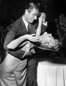 Judy Holliday and Peter Lawford