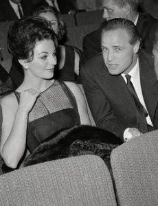 Joan Collins and Marlon Brando