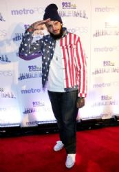 Travie McCoy attends 93.3 FLZÂ's Jingle Ball 2013 at the Tampa Bay Times Forum