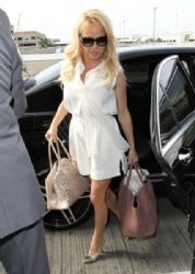 Pamela Anderson departing on a flight at LAX airport