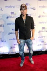Enrique Iglesias attends 93.3 FLZ 's Jingle Ball 2013 at the Tampa Bay Times Forum