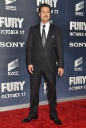 Brad Pitt poses for photographers on the red carpet during the 'The Fury' Washington D.C. premiere at The Newseum