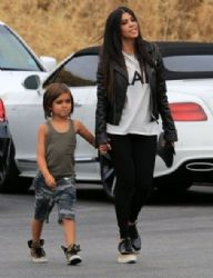 Kourtney Kardashian: filming her reality show 'Keeping Up With The Kardashian's' at a bowling alley in Calabasas