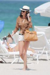 Nicole Trunfio soaks up the sun on the beach while in town for Miami Swim 2012