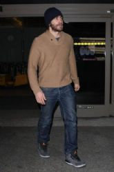 Jake Gyllenhaal arriving on a flight at LAX airport in Los Angeles