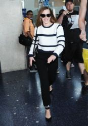 Emma Watson: arriving on a flight at LAX airport in Los Angeles