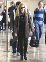 Lisa Kudrow, her husband Michael Stern and their son Julian departing on a flight at LAX airport in Los Angeles, California on December 23, 2012
