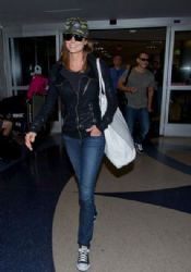 Stacy Keibler and male companion are seen arriving at LAX airport