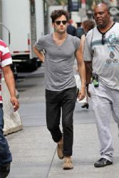 Penn Badgley is seen on the set of The CW's