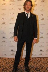 Facundo Arana: classic suit for charity event