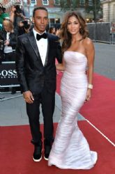 Lewis Hamilton and Nicole Scherzinger attend the GQ Men of the Year awards