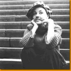 Jeanne Moreau (with a mustache) in