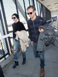 Anne Hathaway and Adam Shulman are seen at LAX