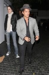 Bruno Mars is seen leaving the Chateau Marmont with DJ Sam Ronson in West Hollywood