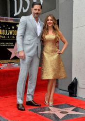 Joe Manganiello poses with Sofia Vergara as she is honored on The Hollywood Walk Of Fame