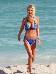 Tara Reid enjoys a beach day with a male friend in Miami