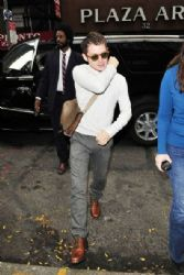 Elijah Wood signs autographs outside of the