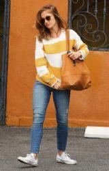 Minka Kelly: running errands in the rain in West Hollywood