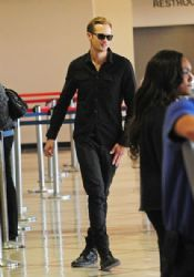 Alexander Skarsgard seen dressed all in black while catching a flight at the LAX Los Angeles Airport