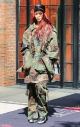 Rihanna rocks an army inspired ensemble while leaving her hotel in New York City