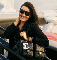 Martine McCutcheon with Chanel bag & sunglasses