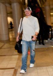 Nick Lachey seems joyful as he arrives at LAX (Los Angeles International Airport