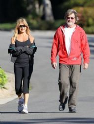 Goldie Hawn enjoys a Monday morning walk with her partner Kurt Russell on February 25, 2013 in Pacific Palisades, California