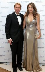 Elizabeth Hurley And Shane Warne Shimmer On The Red Carpet