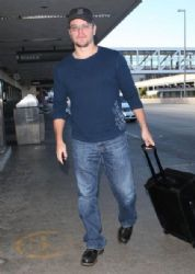 Matt Damon departing on a flight at LAX airport in Los Angeles