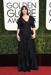 Monica Belluci wears Ralph Lauren :  74th Annual Golden Globe Awards