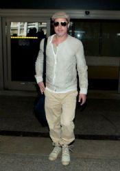 Brad Pitt arrives at LAX airport