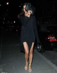 Irina Shayk puts on a leggy display in black minidress as she pays a visit to beau Bradley Cooper at his London hotel