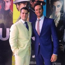 Henry Cavill wears a cream dunhill three piece to The Man from U.N.C.L.E Rio Premiere