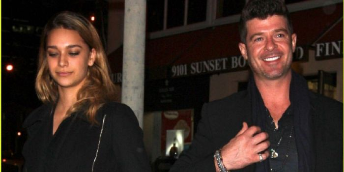 Robin Thicke and April Geary